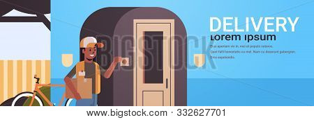 African American Courier Woman Delivering Cardboard Parcel Ringing House Doorbell Express Delivery S