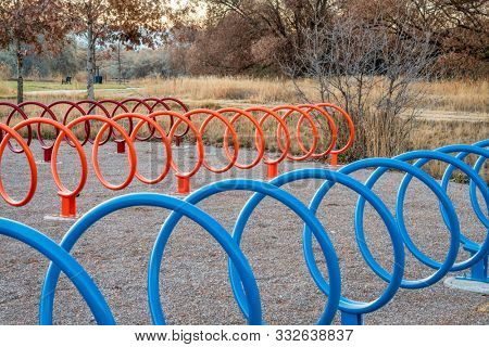 colorful spiral shaped bike racks along a trail in Fort Collins, Colorado - outdoor activity and bike commuting concept