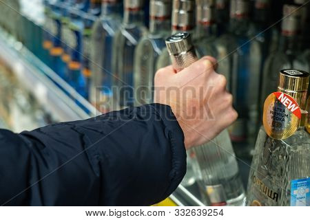 Yekaterinburg, Russia - November 2019. Take A Bottle Of Vodka From A Shelf In The Market. Hand Of A