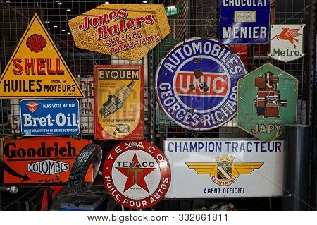 Lyon, France, November 8, 2019 : Old Advertising Plates At The Motorshow. The Salon Epoq Auto Stands