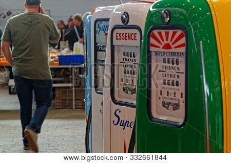 Lyon, France, November 8, 2019 : Old Gas Pumps At The Motorshow. The Salon Epoq Auto Stands In Lyon
