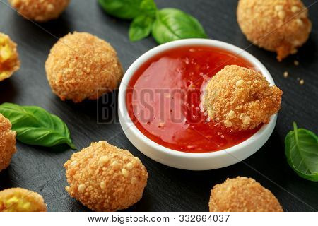 Fried Rice Balls With Sweet Hot Sauce And Wooden Chopstick On Rustic Stone Board