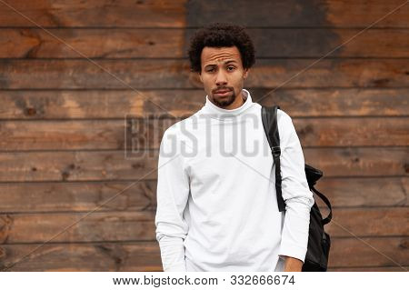 Portrait Of African Man, Pondering A Problem, Doubt.