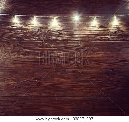 Christmas Lights Decorations On A Rustic Wooden Table. Christmas Or New Year Concept Blur Christmas