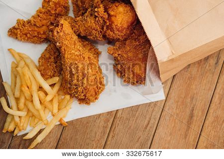 Fried Chicken And French Fries Or Chips (potato)