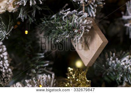 Christmas Background, Selective Soft Focus, Copy Space. Christmas Toy On Decorated Christmas Tree. H