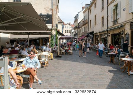 Enjoying Drinks And Food In The Patio Restaurants In The Old City Center Of Dijon In High Summer