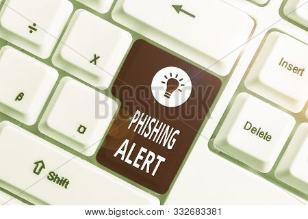 poster of Conceptual hand writing showing Phishing Alert. Business photo text aware to fraudulent attempt to obtain sensitive information White pc keyboard with note paper above the white background.