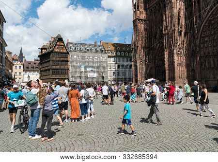 View Of The Strasbourg Cathedral And Many Tourists In High Summer