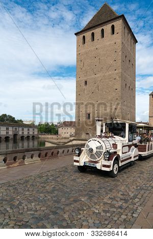 Tourist City Tour Sightseeing Train Driving Through The Historic City Center Of Strasbourg