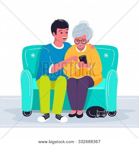 Grandson Helping Grandmother To Use Cellphone. Boy Showing Old Woman How To Make A Call With Mobile