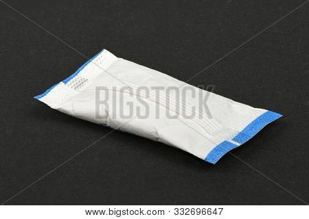 Paper Packet Of Silica Gel Isolated On Black. High Resolution Photo. Full Depth Of Field.