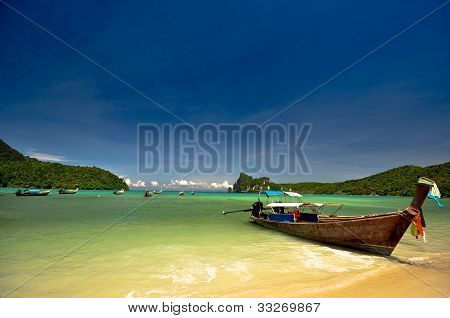 Long tail boat at amazing beach at Phi Phi Island, Phuket, Thailand