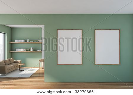 Green Living Room With Sofa And Two Posters