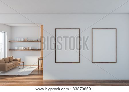 White Living Room With Sofa And Two Posters