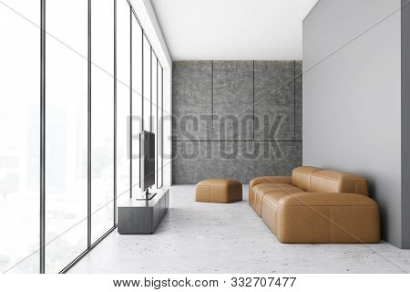White Living Room With Leather Sofa And Tv