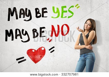 Young Thinking Brunette Girl Wearing Casual Jeans And T-shirt With Maybe Yes Maybe No Sign And Carto