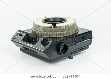 Los Angeles, California, USA - November 9, 2019:  Illustrative editorial photo of old Kodak Carousel Slide Projector model 4200 with white background.  Projector was purchased in 1980.