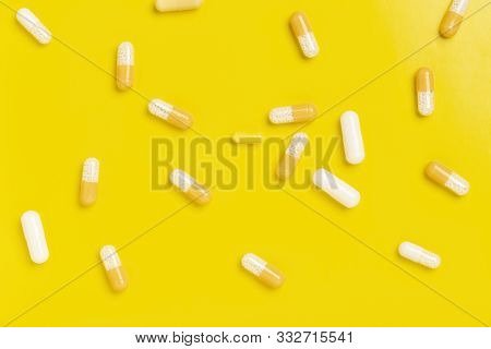Colorful Medicine Capsules On A Single Color Background