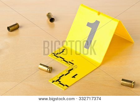 Crime Scene Investigation Csi Evidence Marker With Empty, Fired 9mm Bullet Casings On Wooden Floor B