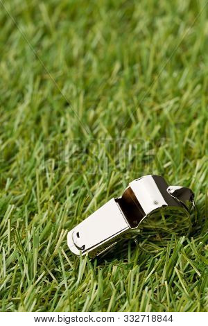Soccer Sports Silver Chrome Whistle On Grass Background - Penalty, Foul Or Sports Concept, Selective