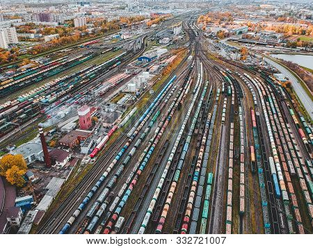 Cargo Trains. Aerial View Of Colorful Freight Trains On The Railway Station. Wagons With Goods On Ra
