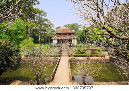 Ancient pavilion and ponds in Imperial Minh Mang Tomb of the Nguygen dynasty in Hue, Vietnam. UNESCO world heritage site