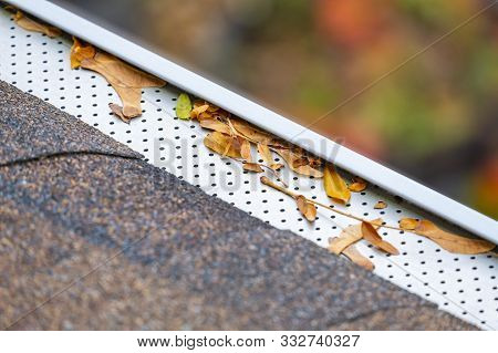 Closeup Of Eaves Trough With Leaf Or Gutter Filter