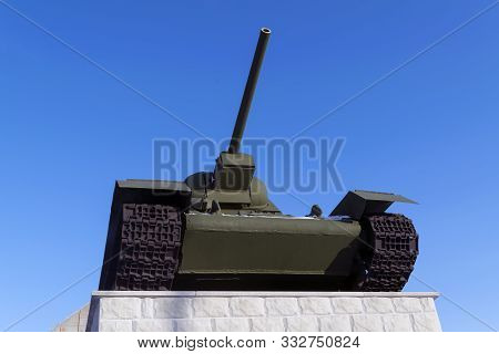 Legendary Soviet Tank T-34 At War In The Second World War On A Blue Sky Background.