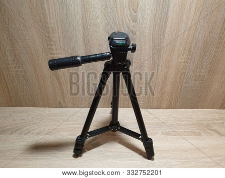 Tripod For The Camera In The Close-up. Tripod Photographer.