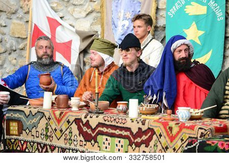 Drobeta Turnu Severin, Romania - 08.31.2019: Medieval Feast Table With Fortress Wall Background