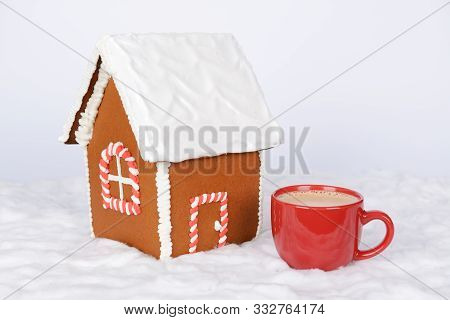 The Hand-made Eatable Gingerbread House And Cup Of Coffee On Red Background