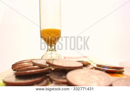 Hourglass, Clock, Coin .  The Great Illusion, The Business Concept Is Continuous, Constantly Operati