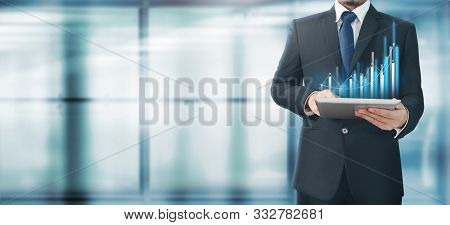 Businessman Plan Graph Growth And Increase Of Chart Positive Indicators In His Business,tablet In Ha