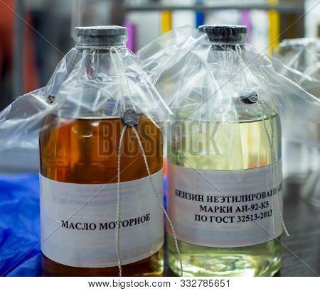 Car Gasoline And Engine Oil Analyzes. Translation Of The Inscription