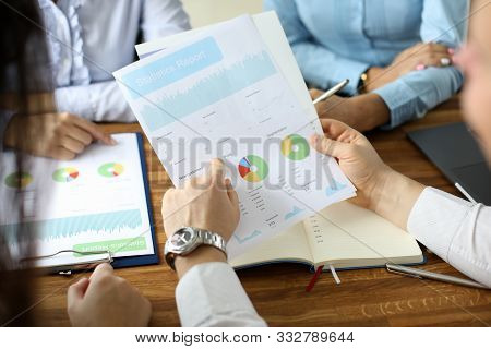 Close-up Of Financial Statement In Businessman Hands. Biz Team Speaking About Statistics Report With
