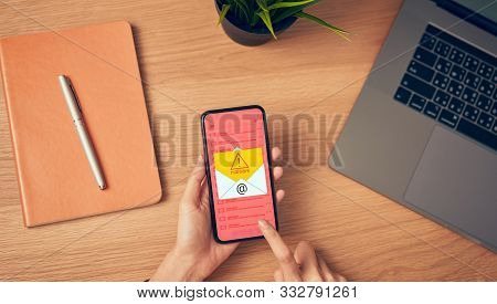 Concept Of Cyber Crime, Hand Holding Smartphone And Show Malware Screen That Comes With Email, Hack