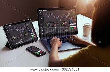 Stock Exchange Market Concept, Businesswoman Trader Looking On Laptop And Tablet, Smartphone With Gr