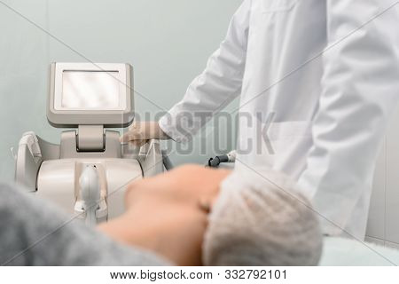 Woman during procedure of facial skin microdermabrasion in beauty salon poster