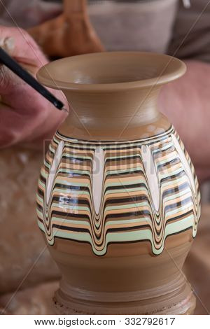 Man pursuing his hoppy in a ceramics pottery class in an workshop