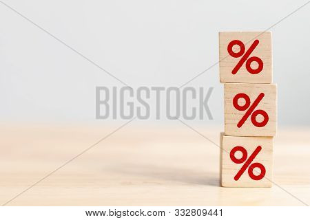 Interest Rate Financial And Mortgage Rates Concept. Wooden Cube Block Increasing On Top With Icon Pe