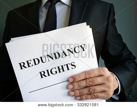Man Is Holding Redundancy Rights Law Papers.