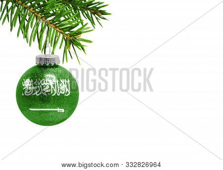 Glass Christmas Ball Toy Isolated On White Background With The Flag Of Saudi Arabia