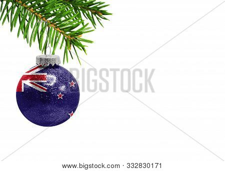 Glass Christmas Ball Toy Isolated On White Background With The Flag Of New Zealand