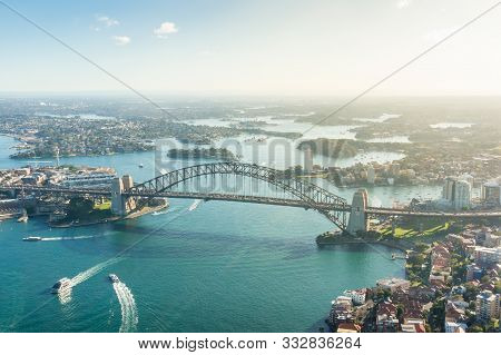 Sydney Harbour Aerial Landscape  With Sydney Harbour Bridge And Ferries With Residential District Bu
