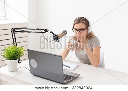 Radio Host, Streamer And Blogger Concept - Woman Working As Radio Host At Radio Station Sitting In F