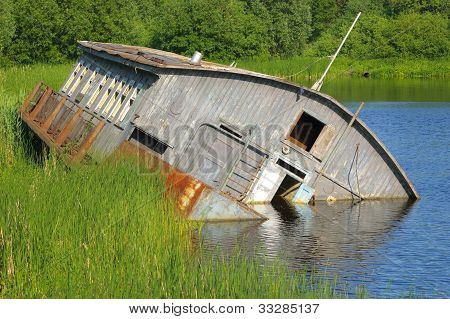 Drifting barge on river
