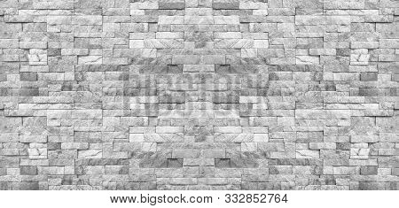 The White Stone Wall Pattern Texture Background.