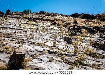 The Dry Patterned Landscape Of Ancient Magma Formations Nearby Maragua Crater On A Clear Blue Sky Da