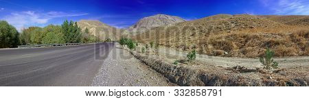 Panoramic Wide Angle View Landscape View Of A Mountain Road In Turkmenistan, Central Asia.